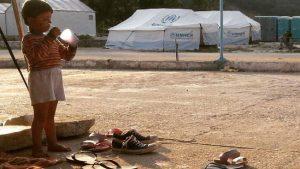 germans-ajudar-refugiats-lestiu
